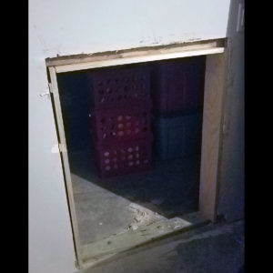 Image of a door being added between the garage and the space below the interior stairs